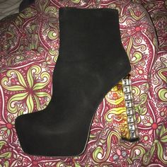 Black High Heel studded bootie. All black suede bootie with gold/clear studs on the heel. Perfect for a night out in the city or special occasion. Only worn once. Shoes Ankle Boots & Booties