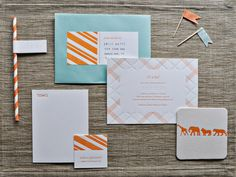 "Dear Lola Paper Products: ""I, of course, loved all the letterpress details and paper goods!"" Sabrena says. ""I designed and letterpress-printed many items for the shower: an invitation suite with patterns of plaid and stripes, coasters with safari animal illustrations, 'it's a boy' favor tags and straw tags, and advice cards that the mama would be able to cherish forever.""  Source: Dear Lola"