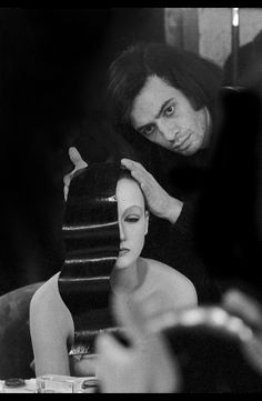 Serge Lutens preparing the model, Isabelle Weingarten, for a picture in the style of Fernand Léger | 1972