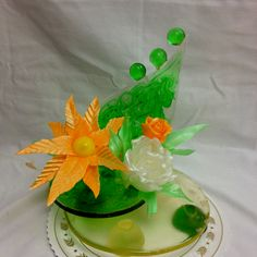 Sugar sculpture with pulled sugar flowers and blown sugar