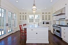 Large white kitchen with large island, colonial French doors. #kitchen @ Building Works Australia