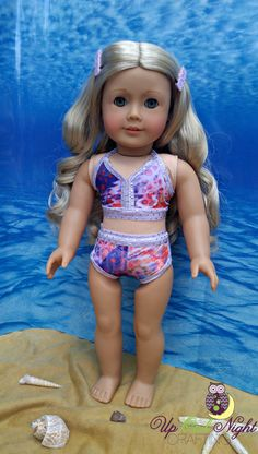 Purple 2 piece bikini by upowlnightcrafting on Etsy. Made from the Take The Plunge Swimsuit pattern. Find it here http://www.pixiefaire.com/products/take-the-plunge-swimsuit-18-doll-clothes. #pixiefaire #taketheplungeswimsuit