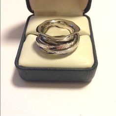 Sterling Silver Artisan Spinner Ring NIB This is a COOL ring! Made by an artisan jeweler, it is solid Sterling with individual textured spinner bands inside. Never worn. Size 8 but will fit more like a 7 or 7.5 due to width and your finger. Artisan Jewelry Rings