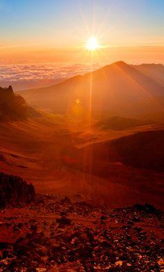 Witness a majestic sunrise atop Mount Haleakala.