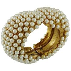 Preowned Alexis Lahellec Vintage 1980s Massive Gold Toned Pearl... ($698) ❤ liked on Polyvore featuring jewelry, bracelets, brown, clamper bracelets, vintage pearl jewelry, pearl jewellery, hinged cuff bracelet, vintage costume jewelry and vintage cuff bracelet