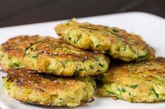 Zucchini Cakes - These zucchini cakes make an elegant appetizer fit for those upcoming Oscar parties. Shredded fresh zucchini, is mixed with a little Parmesan, panko, paprika, garlic and a hint of ground nutmeg. The mixture is then pressed into patties and pan fried in olive oil until they are golden brown.