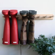 Slim Oak Wellington Boot Rack holds two or three pairs - made in England https://www.willowandstone.co.uk/household-goods/the-boot-room/oak-welly-boot-rack-.php