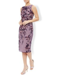 In pretty shades of purple, our Nancy dress features intricate floral embroidery for a standout finish. Beautifully fitted in a midi length with a sophistica...