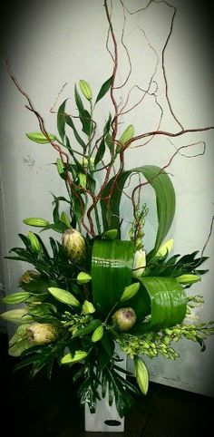 Whites, branches & greens make a stunning arrangement suitable for funeral home or house.