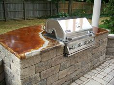 simple outdoor kitchen with a stained concrete counter