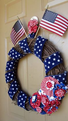 Fast Daze: Americana Porch Makeover - darling wreath, but I think I'd move the flags down into the flowers