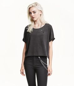 Cropped, oversized T-shirt in washed cotton jersey with hard-worn details, raw roll edges and sewn-in turn-ups on the sleeves.