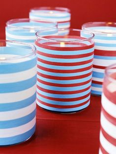 It doesn't get much easier than rubberbands around a glass jar!  Match the rubber bands to the holiday or event. Think about leaving some spaces for more light to escape. Also, you can use some of the many color votive candles offered by BeverlyHillsCandle.com. Try it on the 4th of July.