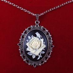 I'm auctioning 'Vintage Black Flower Cameo Necklace' on #tophatter