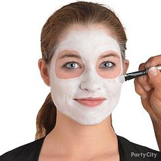 Step 2: Apply white makeup across your entire face leaving two circles around your eyes.