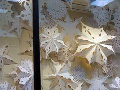 paper snowflake window display
