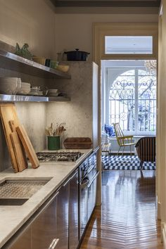 Stainless steel open shelving in a kitchen, Galley Kitchen, Tom Ambler