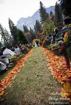 Fall outdoor wedding aisle decorated with leaves