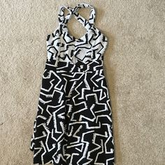 Black and white print dress This black and white printed dress comes to about the middle of the thighs. Never been worn Material Girl Dresses Mini