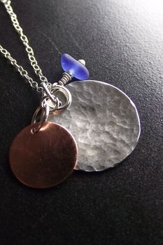 Sea Glass & hammered metal - I like the idea