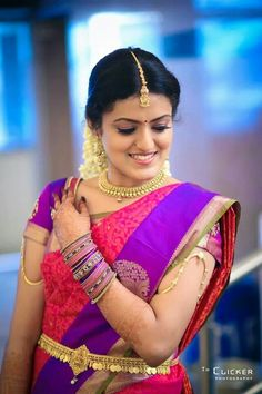 Traditional Southern Indian bride wearing bridal saree, gold jewellery and hairstyle. #IndianBridalMakeup
