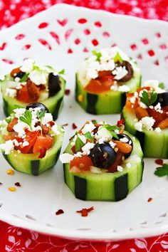 Mediterranean Cucumber Cups | cucumbers + red onion + red bell pepper + vine ripe tomato + black olives + dried oregano + feta + parsley + lemon + EVOO + salt + ground black pepper | Recipe from The Three Little Piglets