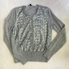 Ann Taylor metallic cardigan Stunning cardigan sweater with little metallic rings that look like sequins in silver with grey 100% extra-fine Merino wool. Excellent condition Like new! Worn once. Tag says medium but fits like a small or extra small , so I am listing it as a small. Ann Taylor Sweaters Cardigans