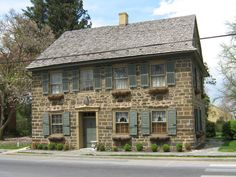 stone, window boxes & shutters -- Old Field Stone House Along Main Street, Strasburg, PA