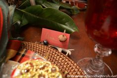 DIY Placecards Made from Cardstock and Acorns nestled in an antler ornament, which could be a party favor.