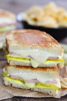 Dill Pickle Wrap Grilled Cheese Recipe on twopeasandtheirpod.com Grilled cheese sandwich made with dill pickles, cream cheese, ham, Fontina, and bread. If you like the classic dill pickle wraps, you will love this sandwich!