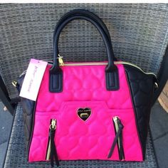 NWT amazing Betsey Johnson bag Brand new with tags...adorable black and hot pink bag with quilted heart pattern has top handles and a removable long strap so it can be worn as shoulder bag or crossbody style. Goldtone hardware with magnetic snap top closure and turn lock front pocket. Inside has a zipper pocket and 2 slip pockets. From a pet and smoke free home. ❌NO TRADES❌ Betsey Johnson Bags
