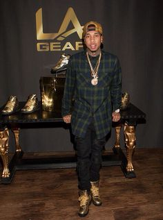 0f5407806 Going for gold: Tyga unveiled his new version of the Eighties classic L.  Gear Lights sneaker - the Liquid Gold Shoe - at the event, and one thing is  for ...