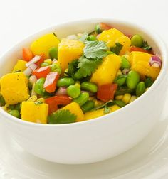 Mango Edamame Salad  2 cups frozen shelled edamame    1½ cups fresh corn kernels  1½ cups mango cubes - (2 mangoes)  1 cup tomato, seeded and chopped  ½ cup chopped red onion  2 Tbsp. chopped cilantro  1 Tbsp. extra virgin olive oil  ¾ tsp. sea salt  ¼ tsp. freshly ground black pepper  Prepare edamame according to package directions. Drain and rinse under cold water. Transfer to large bowl. Stir in remaining ingredients. Toss well