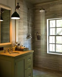 The combination of luxurious veined travertine and industrial design elements is amazing.