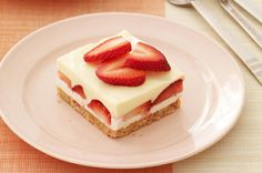 Creamy Layered Lemon Squares recipe - Creamy lemon and fresh strawberry layers make every bite a luscious mix of bright citrus and sweet berry. #NoBakeDesserts