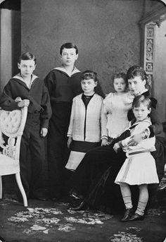 Photograph of Maria Feodorovna, Empress of Russia with her children Tsesarevich Nicholas, Grand Duke George Alexandrovich, Grand Duchess Xenia Alexandrovna, Grand Duke Michael Alexandrovich and Grand Duchess Olga Alexandrovna. 1884