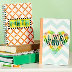 Adding Perler bead designs to school notebooks or journals is a fun way to go from dull to dynamite! Create your own designs for other school subjects. Designed By Karen Benvenuti.