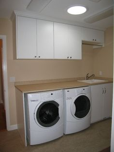 garage laundry room makeover - Google Search, like the way counter wraps down around machine