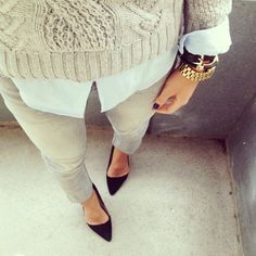 Off-white sweater, white button-up shirt, light grey skinny jeans, black pumps