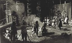 Kwakwaka'wakw tribal member George Hunt (with megaphone) served as a key assistant, contributor and translator for Curtis (at the camera) during the pre-production and production of the dramatic documentary of Hunt's tribe.