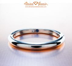 Her birthstone inside his wedding band =) and vice versa