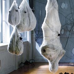 This looks really easy to do on my own - just take a skeleton and some trash bags, wrap them up in spider-webs and cheesecloth, and hang - easy and done!