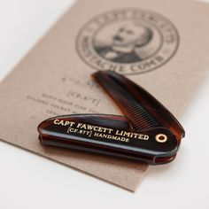 Captain Fawcett's beautifully crafted fine toothed Folding Pocket Moustache Comb (CF.87T) is just the ticket for the grooming, maintenance & styling of ones simply splendid upper lip sweater. Ideal when used in conjunction with the Captain's very own world renowned patent pomades. 'Carry on that Man'... Fawcett