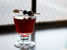 Whitfield Takes Manhattan a blend of Bourbon Vermouth and Cherry Heering