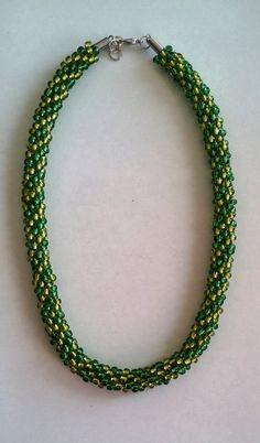 Check out this item in my Etsy shop https://www.etsy.com/listing/227201651/kumihimo-necklace-beaded-green-bold