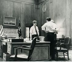 Attorney General Robert F. Kennedy meets with advisors in his office at The Justice Department.