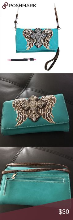 """Rhine Stone Cross Wings Messenger Brand New! Price is FIRM!! 📍 NO TRADES 📍.       About this item Features Leatherette 7.5W x 4.5H x 1.5D """" Magnet closure and wristlet strap 3 interior open pockets,interior and exterior zipper pockets 3 ID pockets and 14 credit card slots 24 """" drop on removable messenger strap plus pen Product Information Blue/Brown Bags"""