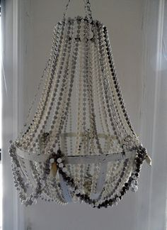 Stella rose chandelier similar to the serena and lily glass bead the thrifty decorator making a chandelier of mardi gras beads and a flower basket aloadofball Images