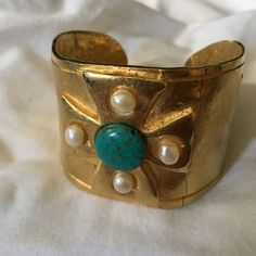 Susan Shaw cuff bracelet Gold with pearl turquoise Gorgeous!!! This Susan Shaw bracelet still has its tag. Purchased from small upscale boutique. The bracelet has a crack from opening slightly to put on. It bends to form to your wrist. May need repair if you don't want the crack showing in putter gold plating. Susan Shaw Jewelry Bracelets