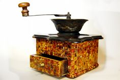 Ancient coffee grinder. Finish: amber mosaic
